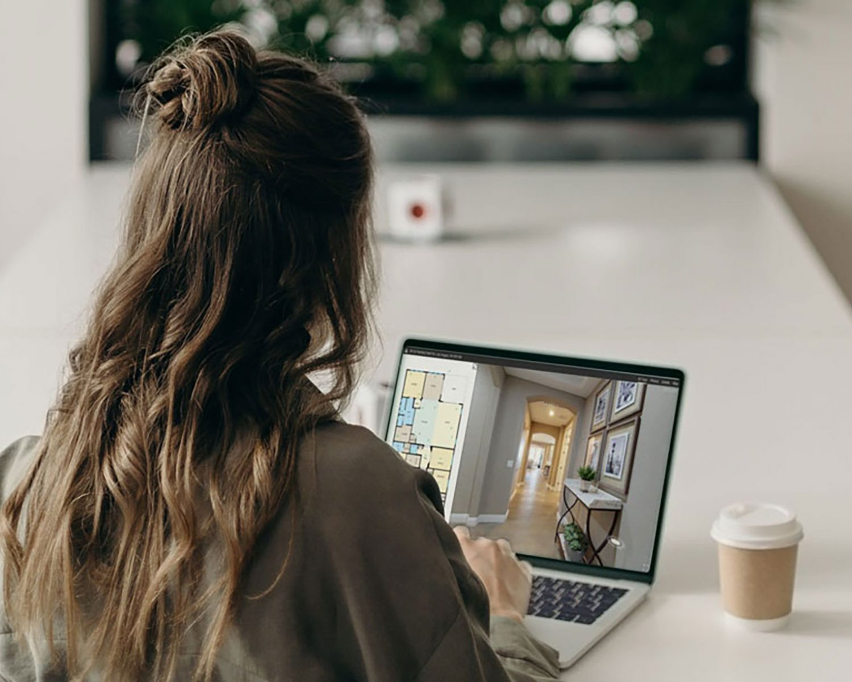 Girl viewing 3D Virtual Tour on Laptop